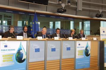 Clivia Conrad and Erhard Ott of the German trade union ver.di follows the hearing