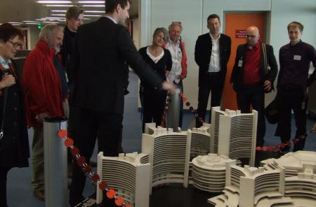 Participants of the guided tour look at a miniature of UN City in Vienna